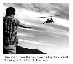 Helicopter hauls materials and comes in for landing