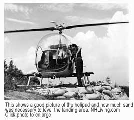 Helicopter on the helipad made of sandbags